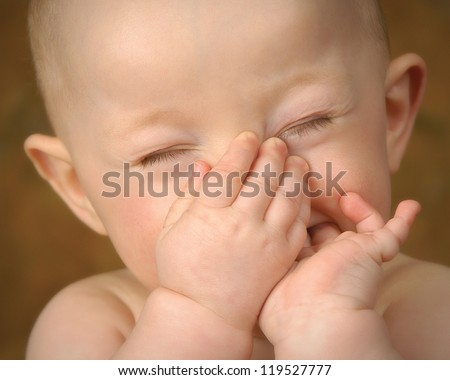 That Smells Baby Holding Nose Close Up - stock photo