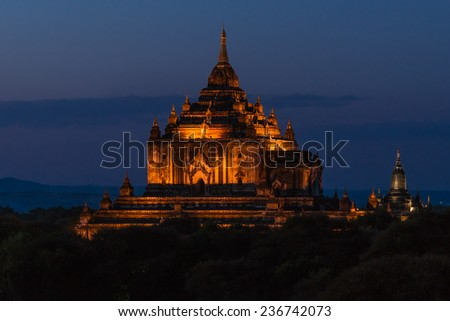Thatbyinnyu Temple, the largest temple at Myanmars Bagan Area, at sunset - stock photo