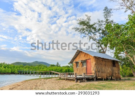 thatched cottage and old bridge in mangrove forest - stock photo