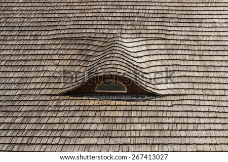 thatched roof with a window on historic cottage in Bohemia - stock photo