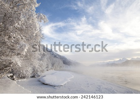 Thaw in the Chilkat River near Haines Alaska in winter. - stock photo