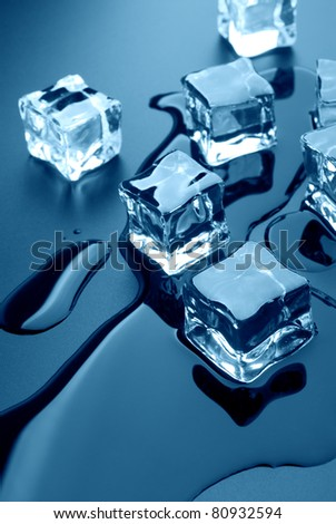 Thawing cubes of ice close up - stock photo