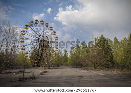 The abandoned Ferris wheel in the amusement park in Pripyat. Chernobyl nuclear power plant zone of alienation - stock photo