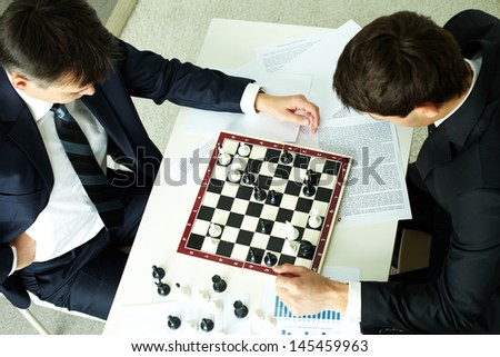The above view of business partners playing chess, conceptual image - stock photo