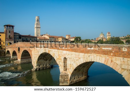 The Adige River that spans the historic center of Verona near the ancient Ponte Pietra - stock photo
