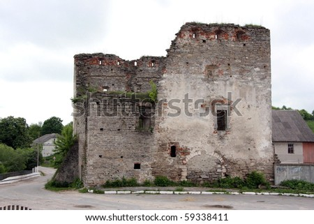 The aged destroyed city gate in the Ukrainian small town - stock photo