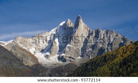 The Aiguille Verte and the Aiguilles du Dru (or Les Drus) in the Montblanc massif, Les Praz de Chamonix, France. - stock photo