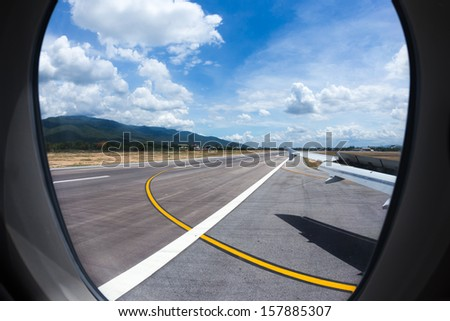 The air plane landing at the airport - stock photo