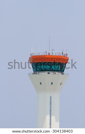 The air traffic control tower in clear sky day. - stock photo