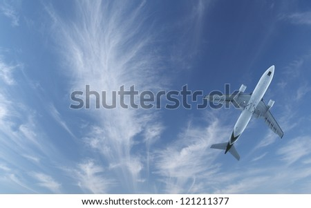 The Airliner flying in the blue sky with cirrus clouds - stock photo