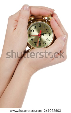 The alarm clock in female hands isolated - stock photo