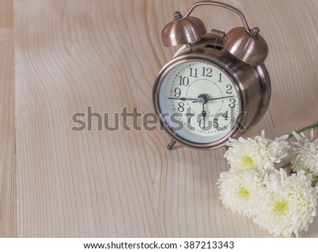 The alarm clock on the table,selective focus - stock photo