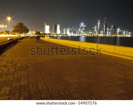 The alley around corniche in Doha, Qatar at night - stock photo