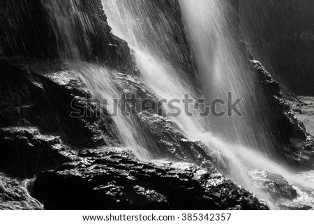 The Alomere waterfall drops from a cliff to the beach along the coast of northern California. This is one of the bay areas most beautiful falls and is found in Point Reyes National Seashore. - stock photo