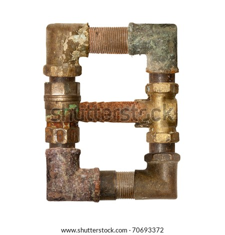 The alphabet of the ancient pipe isolated on white - stock photo