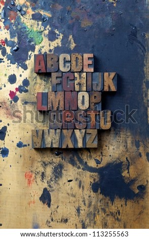 The alphabet written in antique letterpress printing blocks. - stock photo