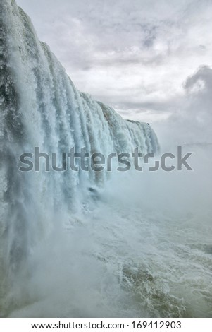 The amazing and beautiful Iguazu falls of South America - stock photo
