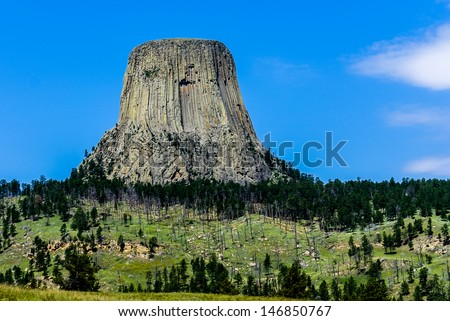 The Amazing Devil's Tower (also called Bear Lodge or Brown Buffalo Horn), is an igneous intrusion or laccolith in the Black Hills, Wyoming, USA. - stock photo