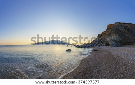 The amazing Legrena coast in Attica - Greece. It is found along the coastal road that leads to Cape Sounion and. The long beach stretches for many meters surrounded by a protected cove with rocks. - stock photo