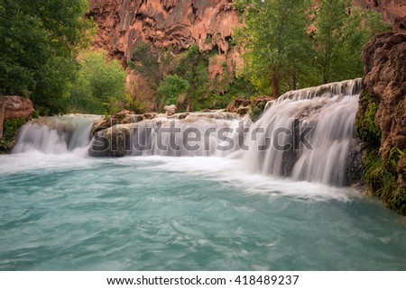 The amazing turquoise color of the limestone fed Havasu Canyon in Arizona - stock photo
