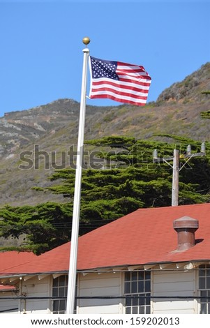 The American Flag blowing in the wind - stock photo