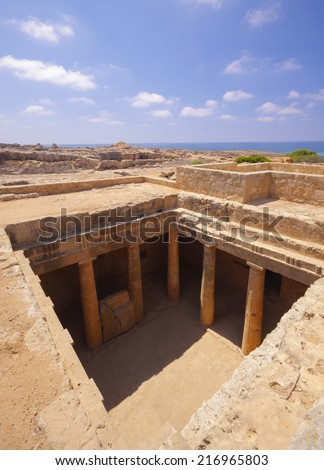 The ancient burial places cut deep into the rock in Paphos - stock photo