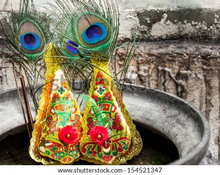 The ancient Chinese peacock feather  with burning Incense in Thailand - stock photo
