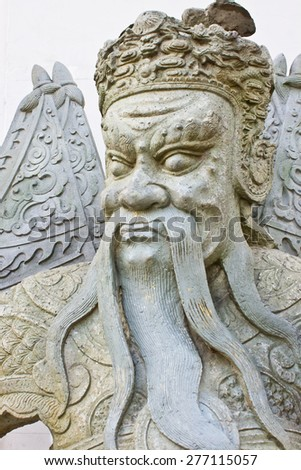 The ancient Chinese warrior statue in Wat Pho or Wat Phra Chetuphon, the Temple of the Reclining Buddha, Bangkok, Thailand - stock photo