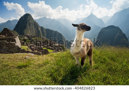 The ancient city of Machu Picchu, Peru. Overlooking ruins on the Inca citadel in the Andes Mountains and the river valley below - stock photo