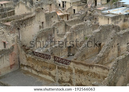 The ancient Roman City of Herculaneum, buried by the eruption of Mount Vesuvius in 79AD, but recently unearthed beneath the modern town or Ercolano near Naples, Italy. - stock photo