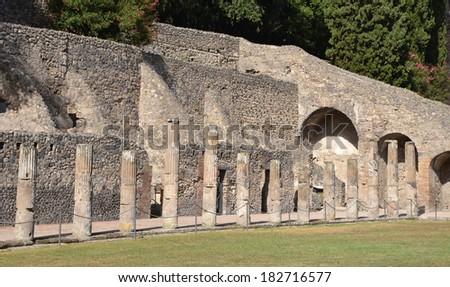 The ancient Roman city of Pompeii. A part of gladiator barracks. - stock photo