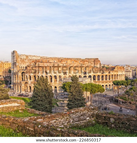 The ancient ruin of the Roman Colosseum amphitheater situated in the Italien capital of Rome. - stock photo