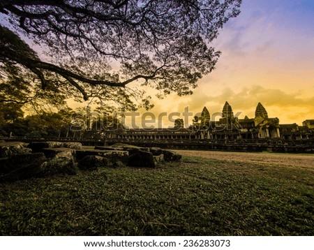The ancient ruins of Angkor Wat at sunset, Cambodia - stock photo