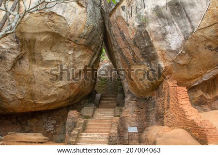 The ancient Sri Lankan rock fortress of Sigiriya is a UNESCO World Heritage Site.  - stock photo