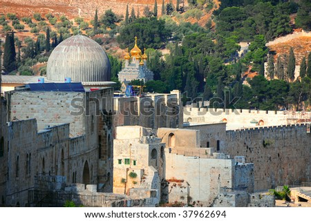 The Ancient Walls Surrounding Old City in  Jerusalem - stock photo