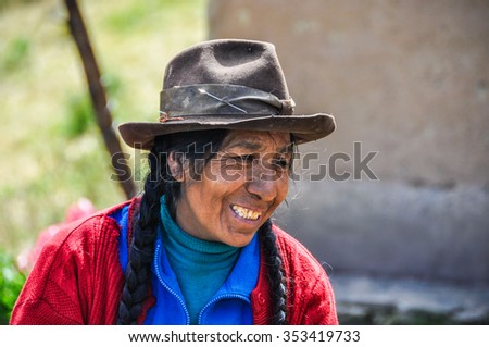 THE ANDES, PERU - JUNE 1, 2012: Quechua woman smiling in a village in the mountains of The Andes over Ollantaytambo, Peru - stock photo