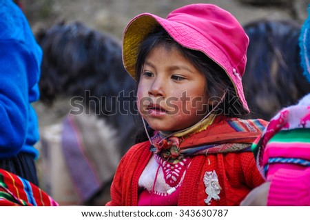 THE ANDES, PERU - MAY 30, 2012: Quechua girl in a village in the mountains of The Andes over Ollantaytambo, Peru - stock photo