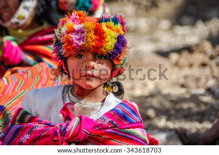 THE ANDES, PERU - MAY 30, 2012: Quechua in a village in the mountains of The Andes over Ollantaytambo, Peru - stock photo