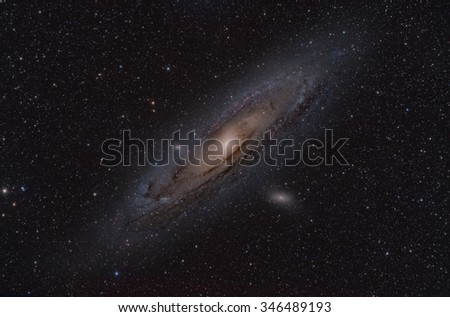 The Andromeda Galaxy imaged in color and hydrogen alpha - stock photo