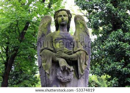 The  Angel and Trees on the old Prague Cemetery - stock photo