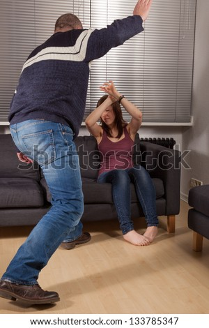 The angry dad is hitting his daughter - stock photo