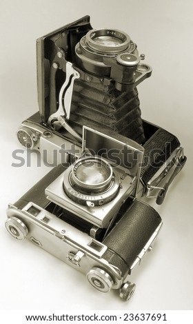 The antiquarian average-format camera and 35-mm camera. - stock photo
