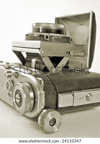 The antiquarian 35-mm camera with put-forward lens. - stock photo