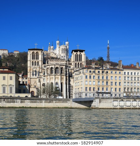 The apse of the Saint Jean cathedral, next to the Saone river, is dominated by the Fourviere basilica - stock photo