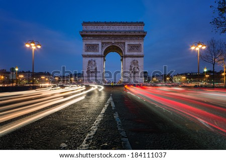The Arc de Triomphe in Paris at night.  - stock photo