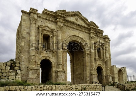 The Arch of Hadrian in Jeresh, Jordan - Jerash is the site of the ruins of the Greco-Roman city of Gerasa. The Arch is an 11-metre high arched gateway erected to honor the visit of Emperor Hadrian - stock photo