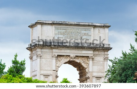 The Arch of Titus is a 1st-century honorific arch, located on the Via Sacra, Rome, Italy, just to the south-east of the Forum Romanum - stock photo