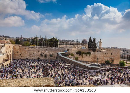 The area in front of Western Wall of Temple filled with people. Jerusalem, the Jewish holiday of Sukkot - stock photo