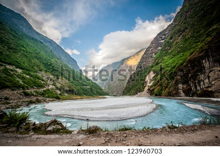The around Annapurna trek in the Nepal Himalaya. The Village of Tal, perched above the Marsyandi Khola river. - stock photo