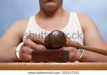 The arrest of the offender in the courtroom  - stock photo